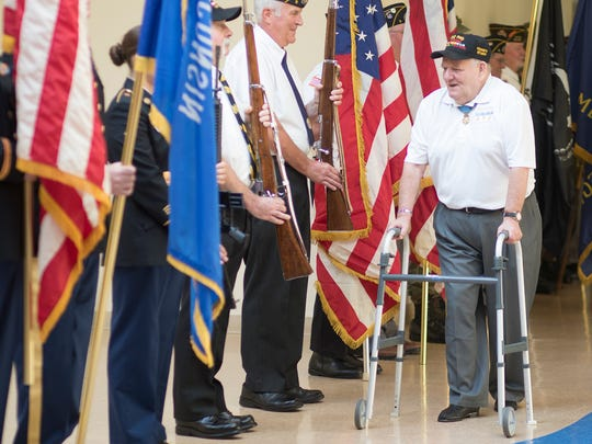 Vietnam War veteran and Medal of Honor recipient Ken Stumpf greets the color guard during the American Heroes Cafe on Wednesday at the Lowell Senior Center in Wisconsin Rapids.
