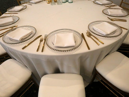 Banquet space with different place settings is available