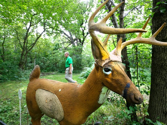 Jeffrey Zuelsdorf, a member of the archery club's board of directors, walks on Thursday past a 3-D target-model deer on the grounds of the Lost Arrow Archery Club. The foam target help archers better visualize the prey.