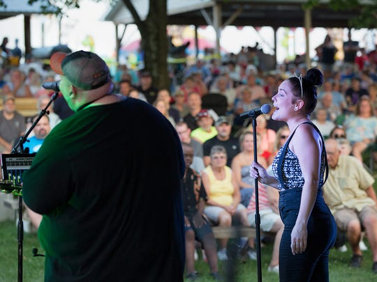 Vocalists for The Big House Band out of Philadelphia Jimi Milligan left, and DaNica Shirey perform at the Pleasant Hill Carnival Friday, July 29, 2016.