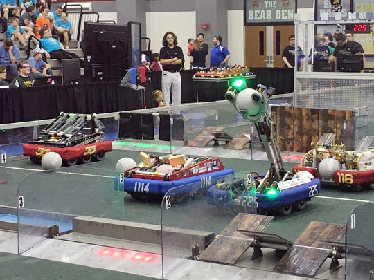 The TechFire 225 robot, second from right, competes