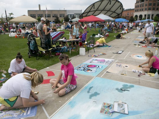 Chalk artists take to the 400 Block for Chalkfest in downtown Wausau, 2015.