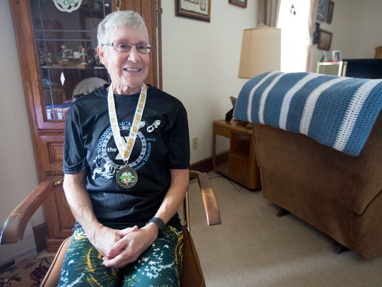 Triathlete Kathy Hermann at her apartment in Stevens