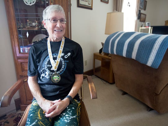 Triathlete Kathy Hermann at her apartment in Stevens Point has plans to compete in the Wausau Triathlon, Saturday, July 2, 2016. She started competing in 2011.