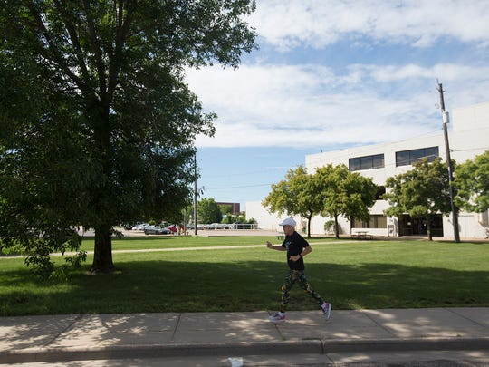 Triathlete Kathy Hermann goes for a warmup run near her apartment in Stevens Point, Saturday, July 2, 2016.
