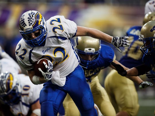 Running back Derek Erdman helped Marcus-Meriden-Cleghorn win the eight-player championship in the school's final solo football season. MMC is now sharing the sport and grades with Remsen-Union and is playing in Class A as MMCRU.