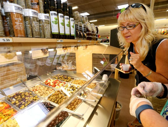Rene Power checks out the olive bar at the new Sprouts