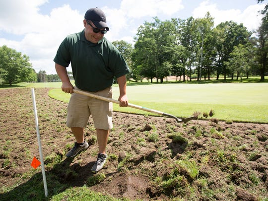 Craig Morelli of Oliphant Companies works on digging