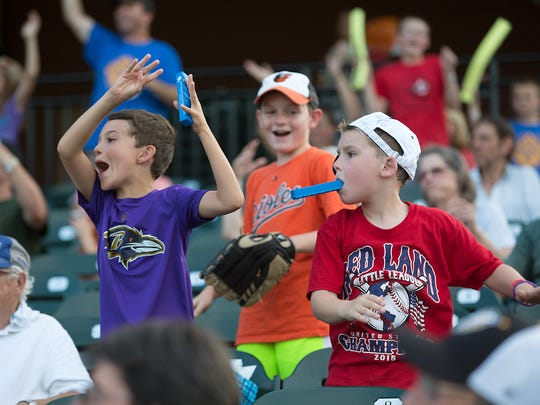 Kids dance in the stands during the York Revolution and Bridgeport Bluefish game Friday at PeoplesBank Park.