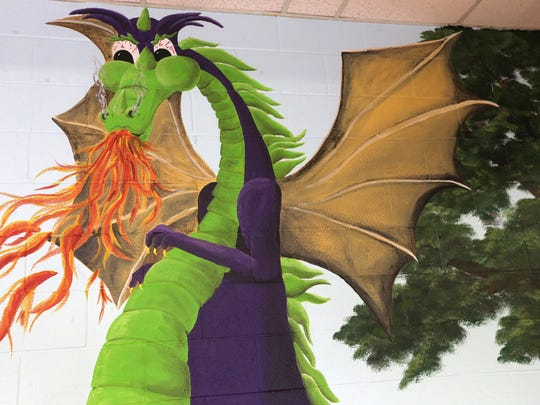 Karen Mullins, said she felt like a rock star when painting the dragon's flames in front of children in the cafeteria at Northfield Elementary school in Murfreesboro. Photos taken on Friday, Aug. 12, 2016.