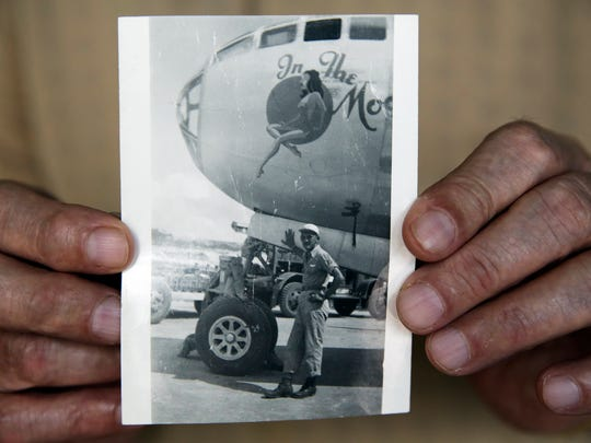 WWII veteran Harold Leavitt, 94, is shown in a photograph standing in front of a plane from his time serving in the war, at Homer Helter's Antique & Military Mall on Friday, Aug. 12, 2016. Leavitt was shot down while flying on a B-29 bomber and was held for five months as a prisoner of war.