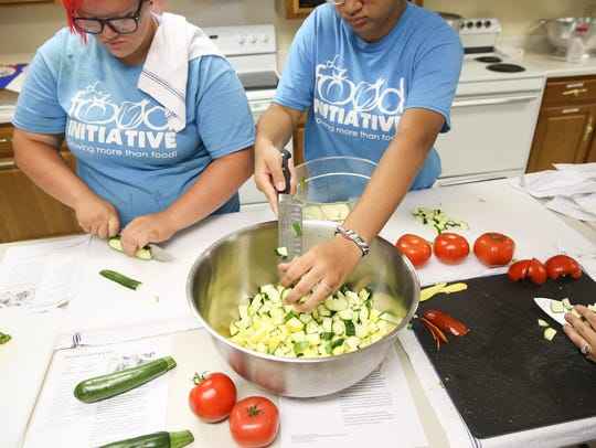 The Food Initiative Summer Youth Program students chop