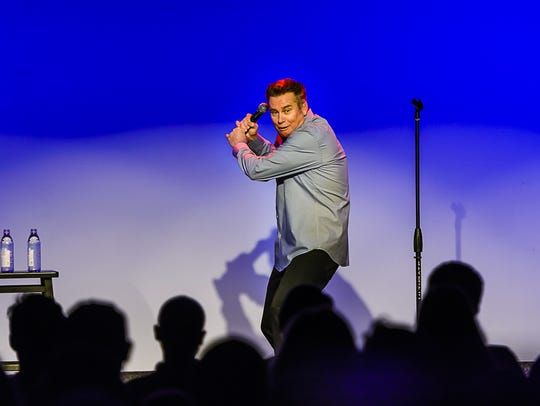 Comedian Brian Regan performs during a Make-A-Wish