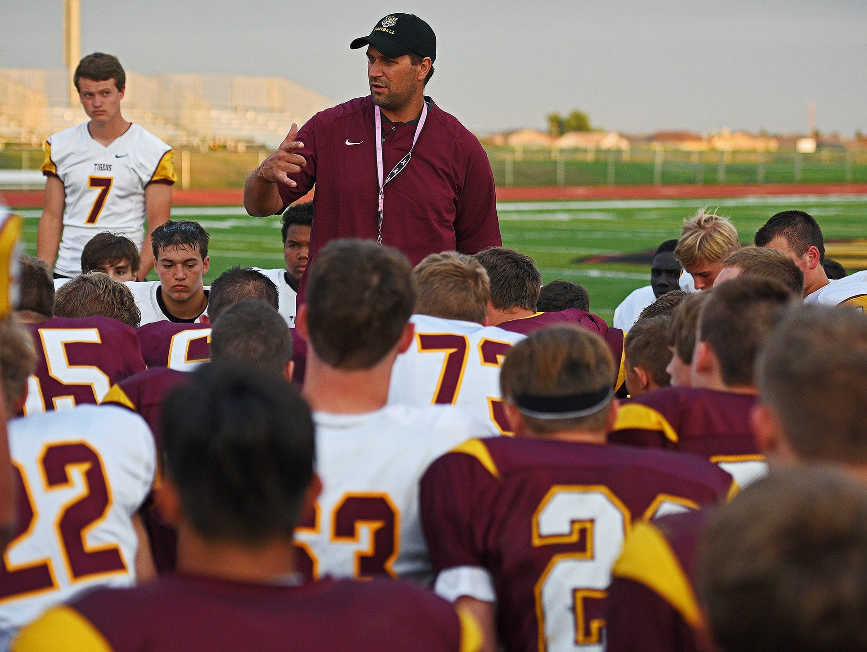 Harrisburg head football coach Brandon White speaks to his team after a scrimmage Friday, Aug. 19, 2016, at the Harrisburg High School in Harrisburg, S.D.