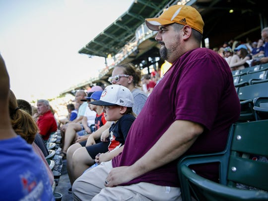 Patrick Segura, along with son Gage, 6, and wife Katie, wait for the start of the Indianapolis Indians game on July 30, 2016.