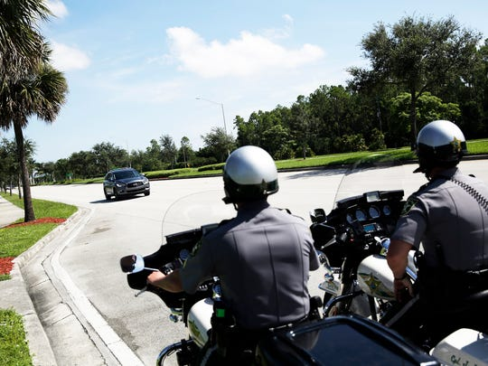 Deputy Robert Reuthe, right, and Sgt. Dale Dear monitor traffic on Livingston Road in Naples as a part of the aggressive driving initiative through the Collier County SheriffÕs Office on Tuesday, Aug. 23, 2016.