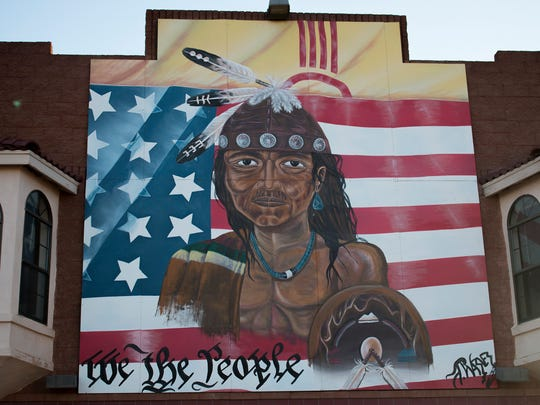Mural of a Native American on the side of a trading post that sold goods from tribes on the Navajo Nation near Gallup, New Mexico.