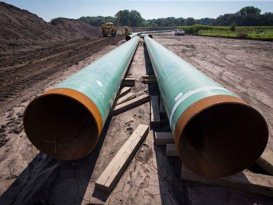 A bending crew wrangling pipe for the Bakken pipeline