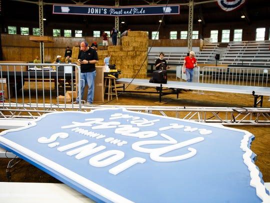 Volunteers set up Pioneer Pavilion for Joni Ernst's