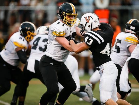 Bettendorf's Mark Kallenberger, an Iowa recruit, blocks