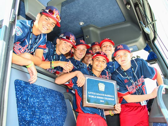 The Little League world champs show off their plaque just before getting off the bus at Struble Field.