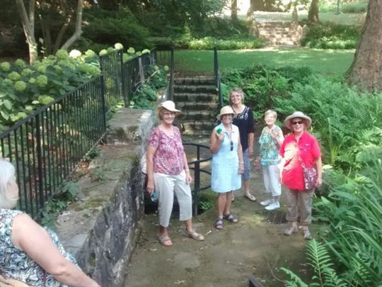 Nine Heritage Garden Club members toured the Kilgore-Lewis House and Gardens July 14.