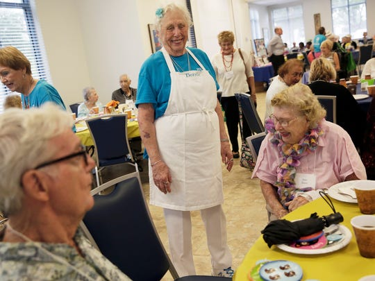 Dorrie Karnis, 86, of Naples greets some of the seniors before serving a hot lunch at the Naples Senior Center on Wednesday, Aug. 31, 2016. Karnis has been volunteering at the Senior Center for almost 3 years.