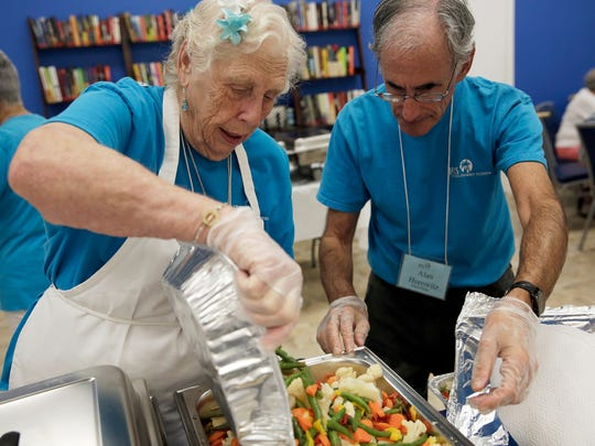 Dorrie Karnis, 86, left, and fellow volunteer Alan Horowitz, 69, help prepare for hot lunches at the Naples Senior Center on Wednesday, Aug. 31, 2016. Karnis has been volunteering at the Senior Center for almost 3 years.