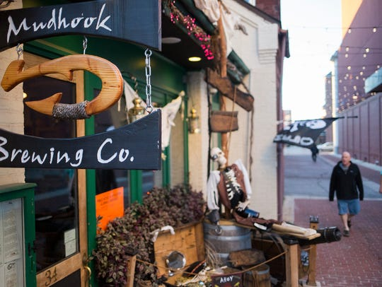 Customers arrive at Mudhook Brewing Co. in York. Mudhook