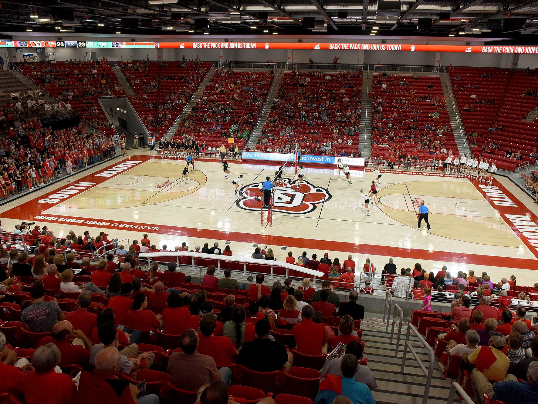 The Sanford Coyote Sports Center is packed to watch USD women's volleyball team play UND on Tuesday in Vermillion.