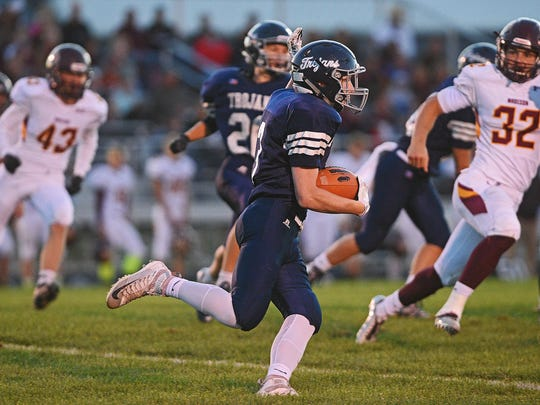West Central's Dan Waldner (3) carries the ball during
