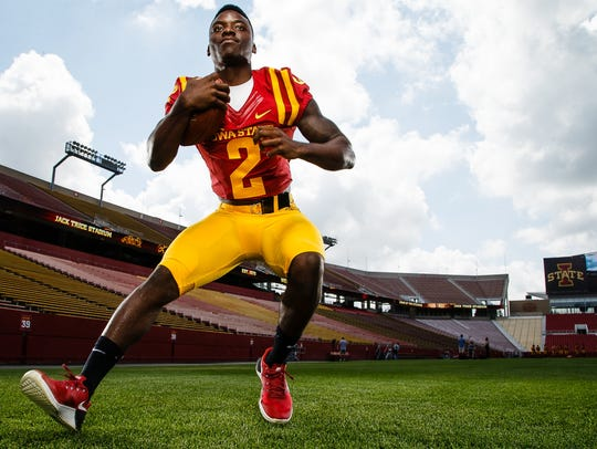 Cyclones Mike Warren poses for a portrait during media