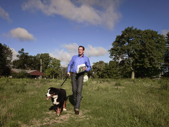 Chris Jerome of the Capital Gateway Project, LLC, walks with his dog Bentley on the grounds of the former Red Cedar Golf Course in 2012. Jerome and his father Leo filed a federal suit against Joel Ferguson, Mayor Virg Bernero, LEAP CEO Bob Trezise and others alleging violations of federal rackeeting laws  in 2016. A judge dismissed that lawsuit on September 28, 2018.