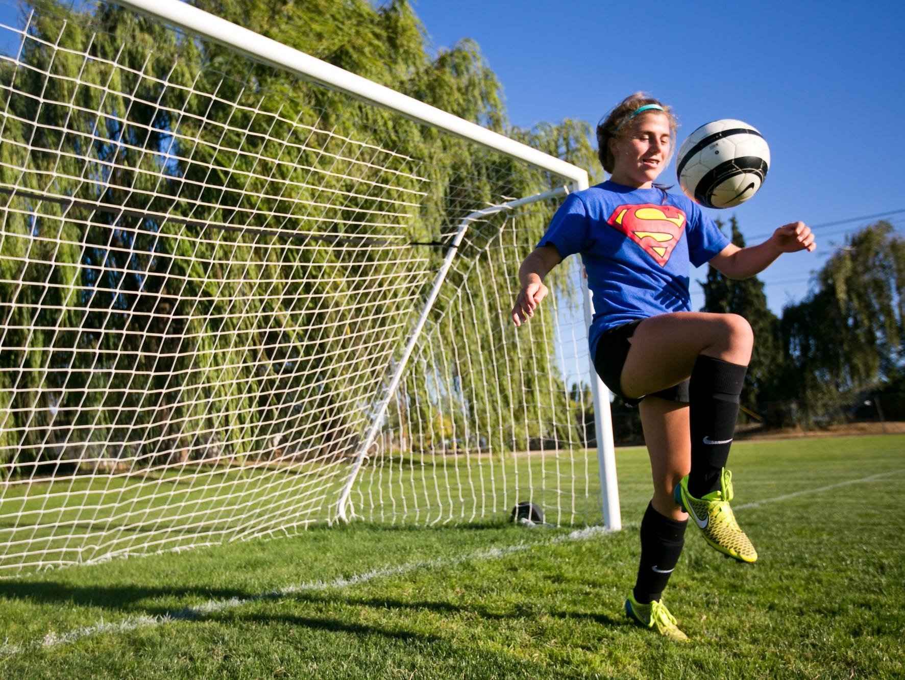 Defensive center midfielder Emily Collier juggles the ball at a practice for Blanchet Catholic School on Monday, Sept. 12, 2016.