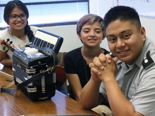 Bowie High School students in the school's mariachi program talk about their school Wednesday on campus.