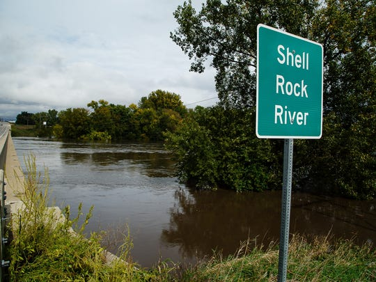 The Shell Rock River swells past its banks on Thursday,
