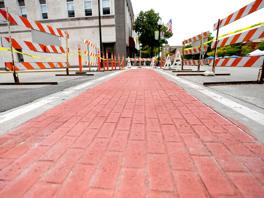 Brick crosswalks are readied to be removed in downtown