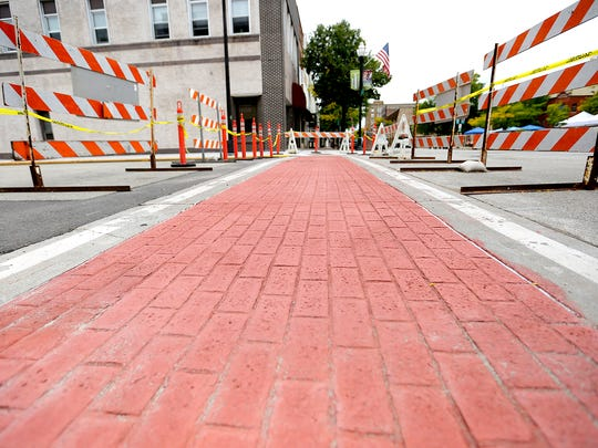 Brick crosswalks are readied to be removed in downtown Fond du Lac.  Constant replacement of bricks prompted the city to tear them out and put in colored, stamped concrete.