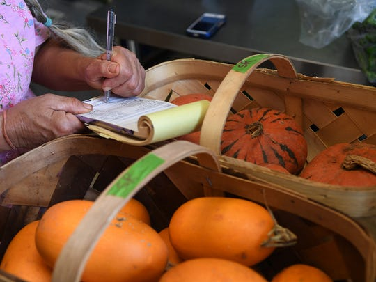 Margie Levine of Crescent Farm drops her produce off at Swamp Rabbit Grocery on Wednesday.