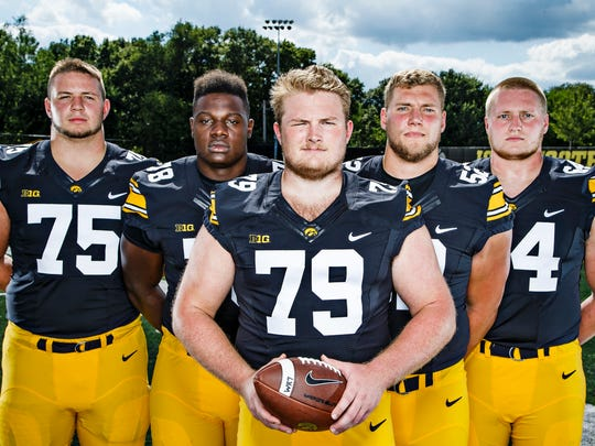 The Hawkeyes offensive line, from left, Ike Boettger, James Daniels, Sean Welsh, Boone Myers, and Cole Croston pose for a portrait during media day on Saturday, August 6, 2016 in Iowa City.