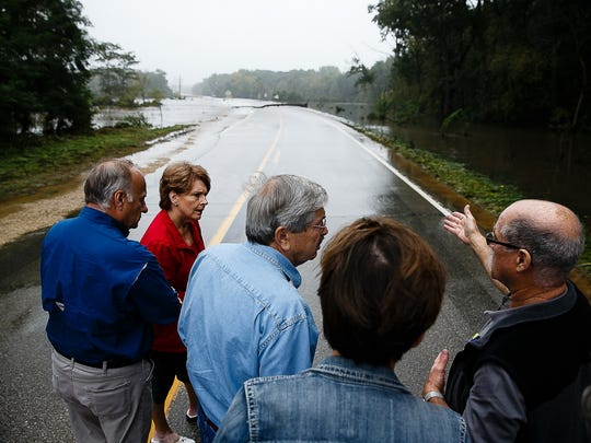 Government officials, including U.S. Rep. Steve King, left, Gov. Terry Branstad, center, and Lt. Gov. Kim Reynolds, tour Clarksville, which was hit hard by the heavy flooding on Saturday, Sept. 24, 2016.