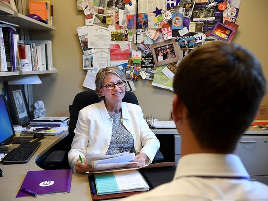 Beth Crews meets with Greenville Technical College student John Wood in her office on the Furman University campus on Monday.