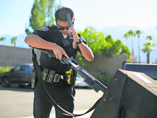 Palm Springs police officer Daniel Buduan inspects a shotgun during a patrol in 2015.