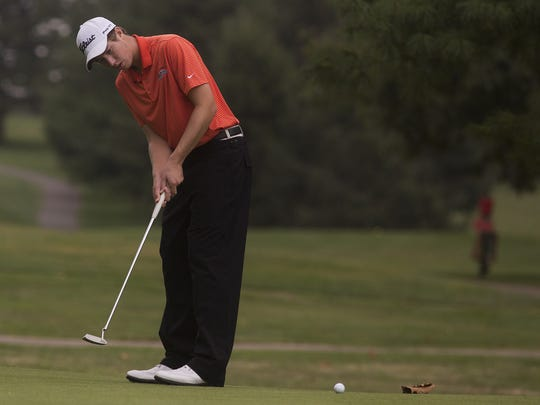 Central York's Joe Parrini putts Wednesday at the YAIAA team golf championships at Briarwood Golf Club.