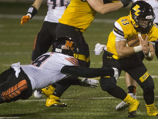 Red Lion's Dylan Gurreri, right, carries the ball as