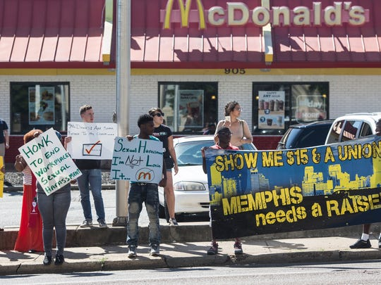 October 6, 2016 - People hold signs outside of the McDonald's in the 900 block of Union while protesting workplace sexual harassment.