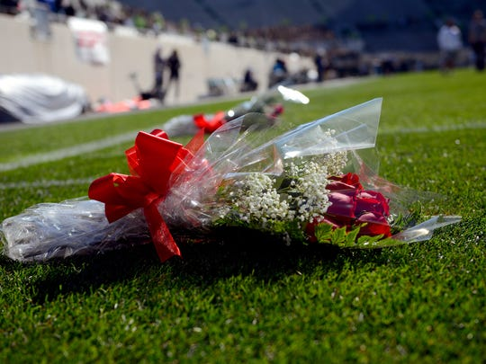 Two bouquets of roses sit on the three- and six-yard-line