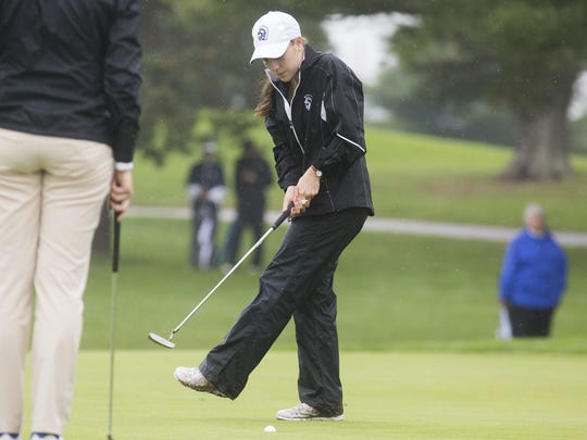 Chambersburg's Mary Kate Norcross, who shot 81, coaxes in a putt at the District 3 3A girls golf championships at Briarwood West on Saturday.