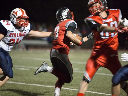 Dover's Derek Arevalo broke an arm tackle by Tate Myer