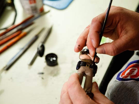 Bryan Guise makes bobbleheads in parents' garage in
